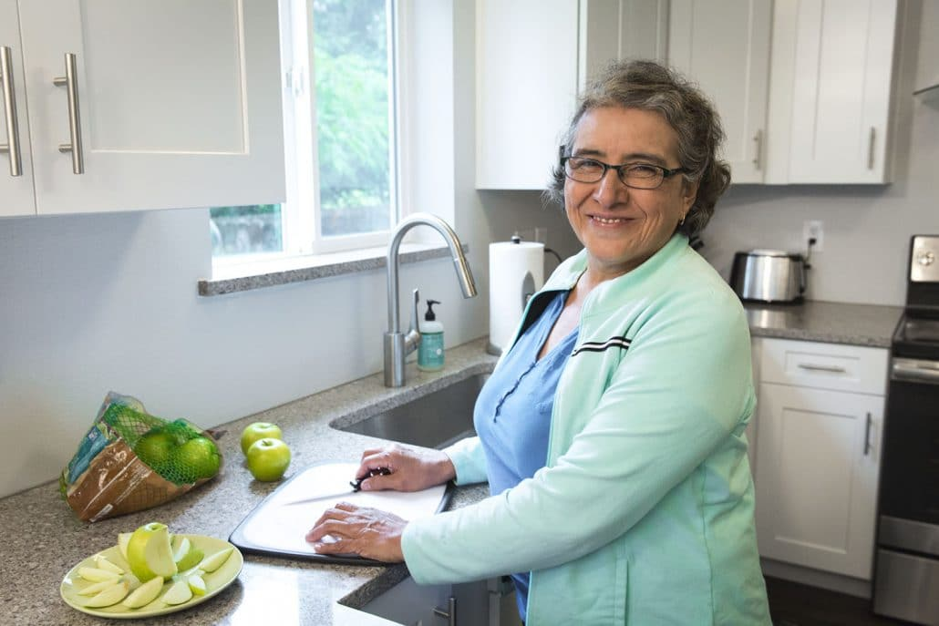 Homecare Worker cutting apples