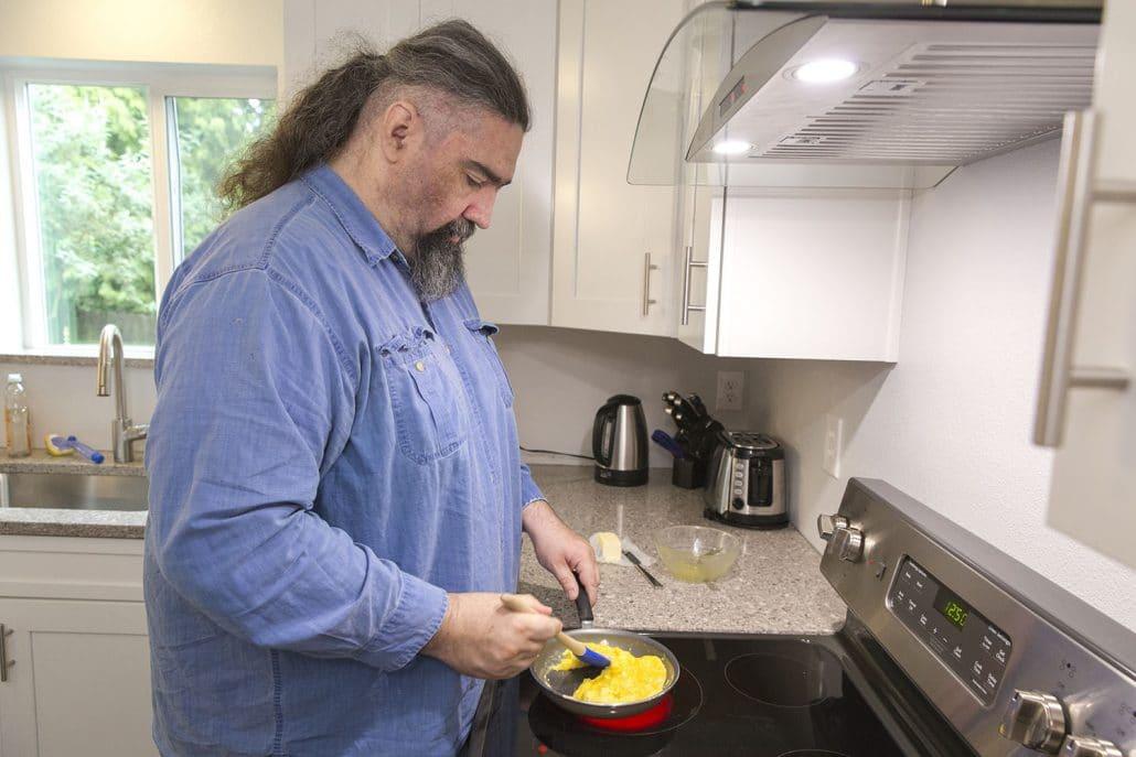 Homecare Worker making eggs